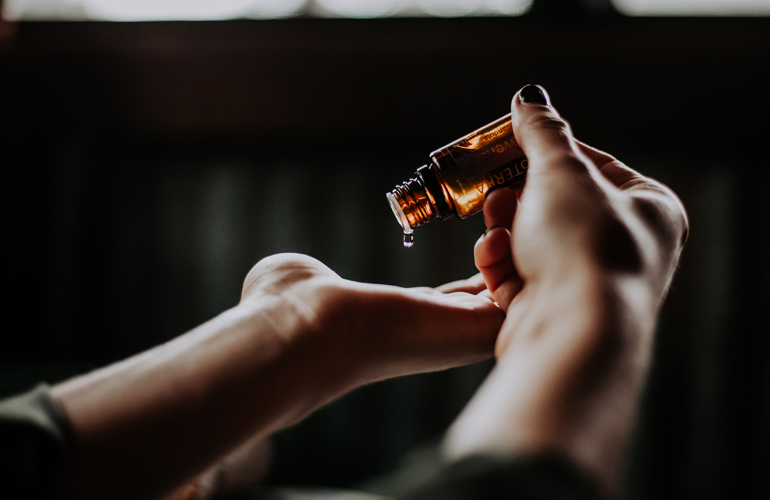 Essential oil being dripped from bottle (c) Christin Hume